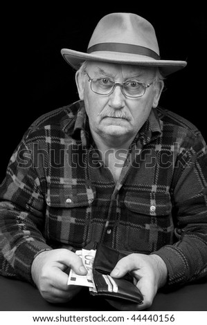 photo senior male with money issues on black background
