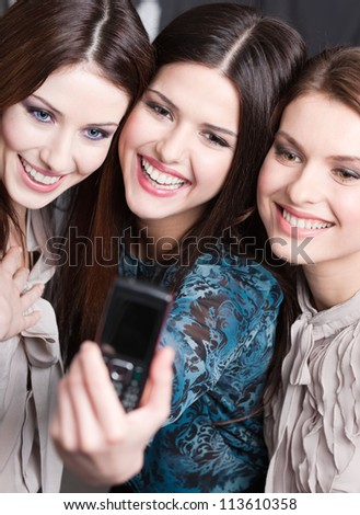 Photo session of three young women with dark hair - stock photo