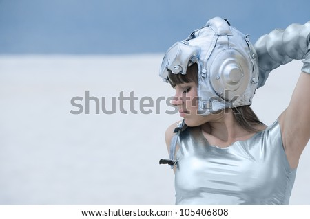 Photo sexual young girl in an interesting dress posing on the beach - stock photo