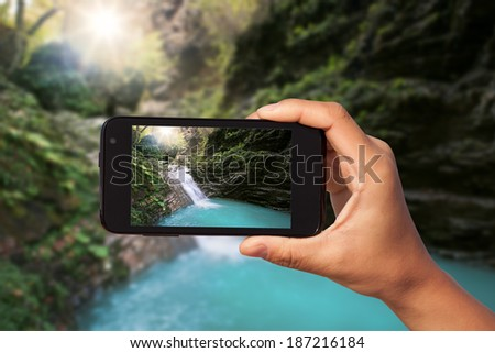 photo shooting on smartphone in tourist journey - stock photo