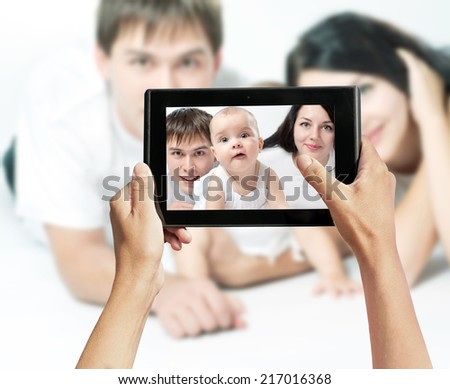 photo shooting on tablet pc, family - stock photo