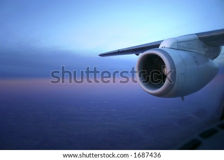 Photo showing jet engine in early morning light - stock photo