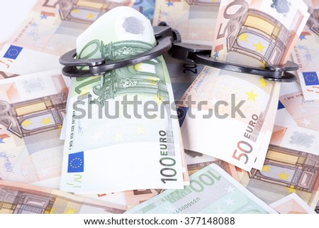 photo showing money with handcuffs