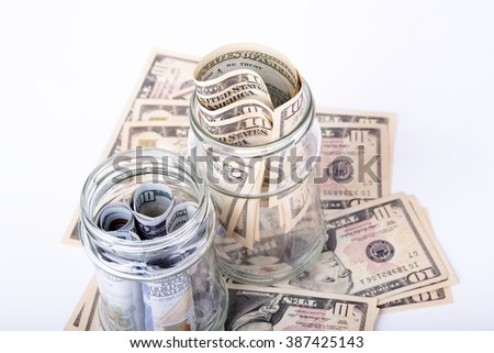 photo showing the savings in dollars hidden in a jar