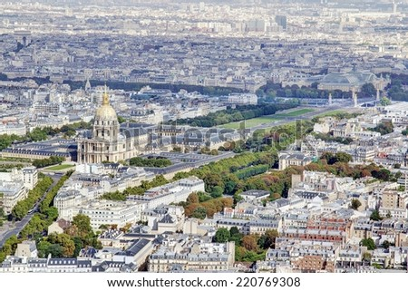 Photo shows Parisian cityscape taken on the skyscraper with various houses and monuments.