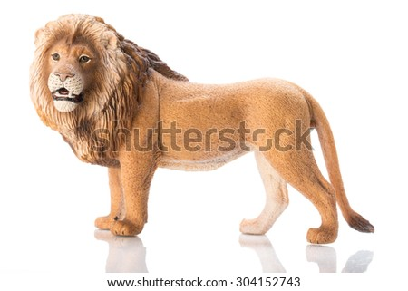 Photo shows the toy lion on white. on white.