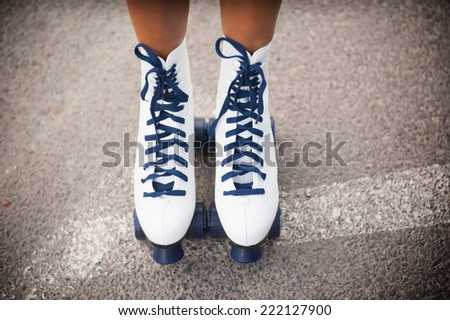 Photo Sports rollers skating female legs wearing - stock photo