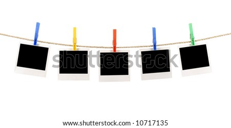 Photo string : several blank instant camera photo prints hanging on a rope or string isolated on a white background.