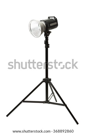 photo studio flash light on the tripod, isolated on white