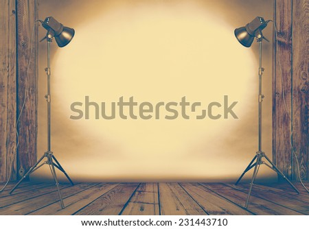 photo studio in old wooden room with concrete wall and paper background , retro filtered, instagram style - stock photo