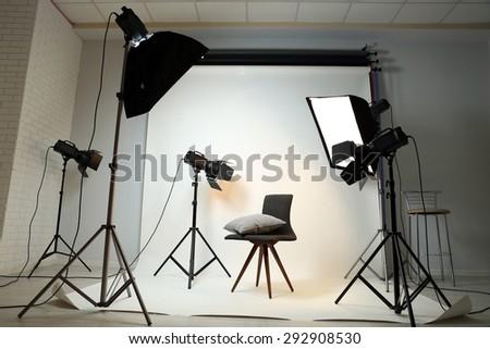 Photo studio with modern interior and lighting equipment - stock photo