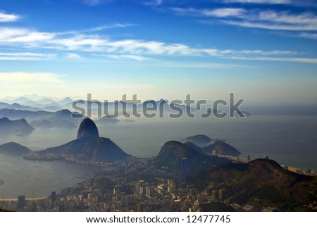 Photo taken a the feet of the Christ the Redeemer statue aiming Sugarloaf mountain - stock photo