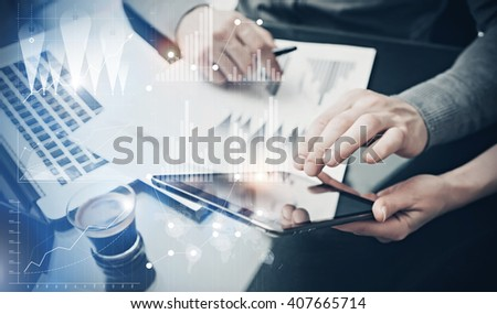 Photo teamwork process. Finance department managers working new global project in office. Using electronic devices. Graphics icons, worldwide stock exchanges interface. Horizontal - stock photo