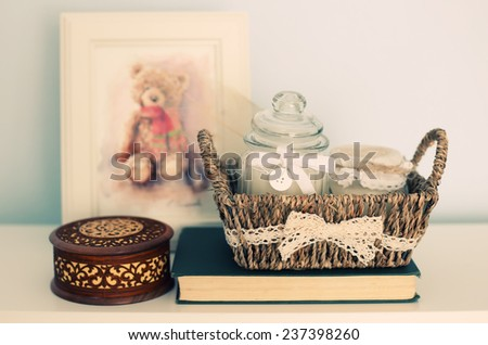 Photo with basket, box, picture and candles on wood - stock photo