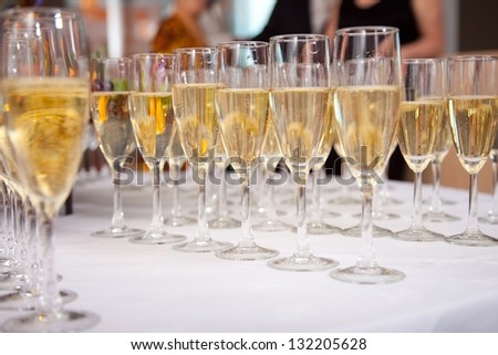 photo with glasses of champagne on festive table - stock photo