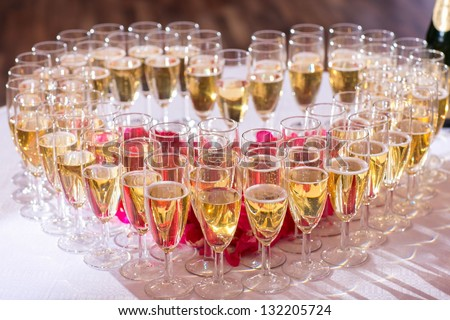 photo with heart of  glasses of champagne on festive table - stock photo