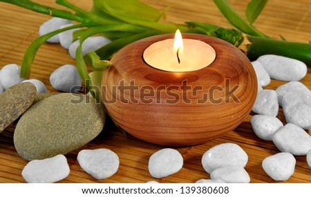 PHOTO WOODEN CANDLE WHITE STONES FOR SPA