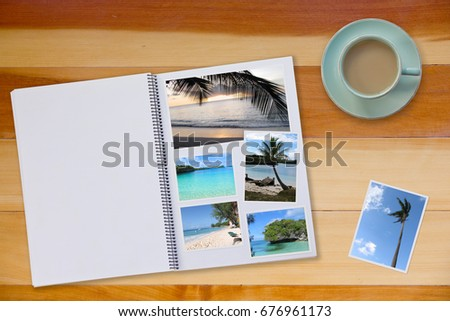 Photobook Album  with Travel Photo on Wooden Floor Table with Travel Photos and Coffee or Tea in Cup