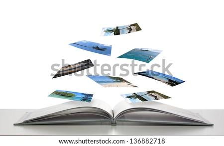 Photobook with Photos of Beach Scenes Floating  - stock photo