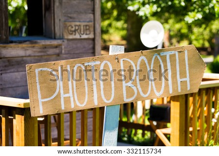 Photobooth sign outdoors at a wedding reception in Oregon. - stock photo