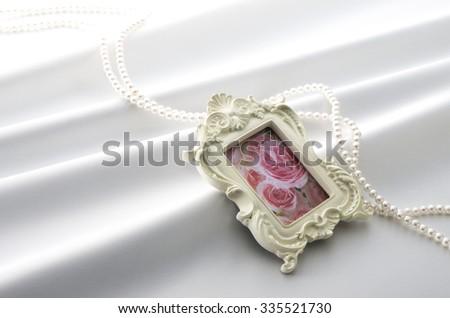 Photoframe and cloth drape - stock photo