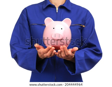 photograph of a bust of a woman in blue work uniform holding a piggy bank