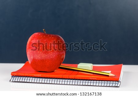photograph of a desk in a school any - stock photo