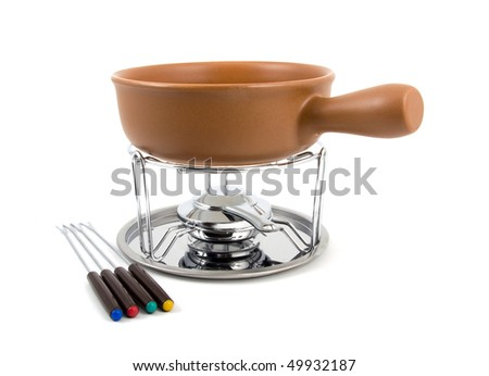 Photograph of a fondue pot isolated on a white background