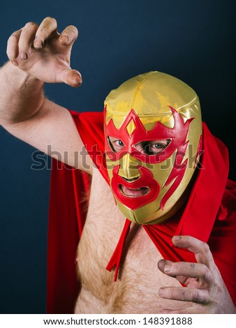 Photograph of a Mexican wrestler or Luchador standing in a fight pose. - stock photo