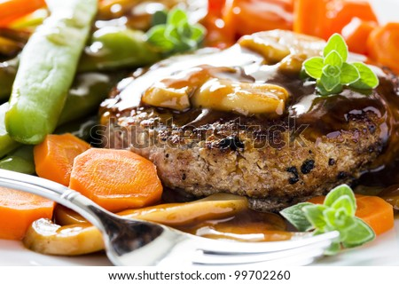 Photograph of a tasty dish of burger and vegetables