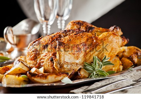 Photograph of a tasty roasted chicken served in a plate