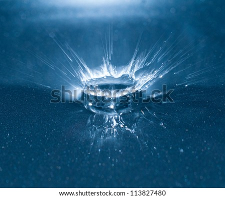 photograph of a water droplet and the hitting point on a base causing an electric abstractly