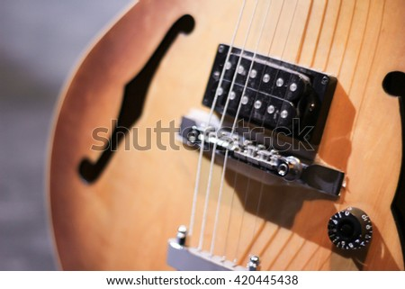 Photograph of a wood guitar - stock photo