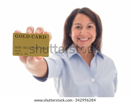 Photograph of a young mixed-race woman proudly displaying her Gold Card. - stock photo