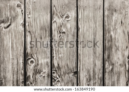 Photograph of antique rustic Pine wood fence - detail. - stock photo