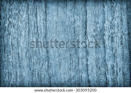 Photograph of Bleached and Dark Blue Stained Walnut Wood vignette grunge surface texture. - stock photo