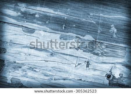 Photograph of Blue stained old, weathered, varnished wooden laminated panel, stained, cracked, scratched, vignette grunge texture.