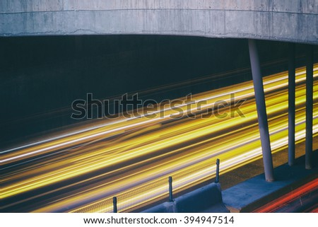 Photograph of blurred car lights on an urban scene with a long exposure effect