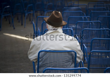 photograph of loneliness in old age. - stock photo