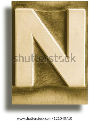 Photograph of Metal Letterpress Sepia Letter N - stock photo