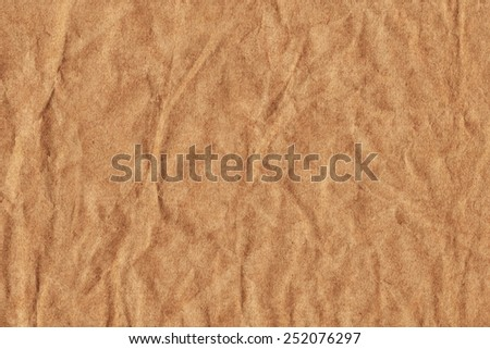 Photograph of old Recycle Kraft Brown Paper, coarse grain, crushed crumpled, grunge texture sample.