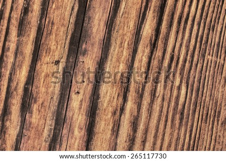 Photograph of old, roughly treated, weathered, cracked, rotten, knotted Pine plank grunge texture.