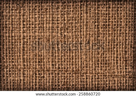 Photograph of raw, roughly woven, extra coarse grain, burlap vignette grunge texture.  - stock photo