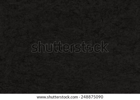 Photograph of Recycle Dark Charcoal Black Paper, coarse grain, blotted, mottled, grunge texture. - stock photo