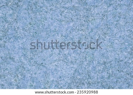 Photograph of Recycle Kraft Powder Blue Paper, coarse grain, blotted, mottled, spotted, grunge texture. - stock photo