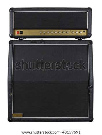 Photograph of the front of an old combo guitar amplifier with speaker cabinet. - stock photo