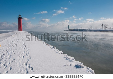 Photograph of the Kenosha, Wisconsin harbor on a sub-freezing winter morning, the warm waters of the lake causing a blanket of steam. - stock photo