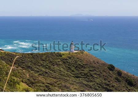 Photograph of the lighthouse at Cape Reinga on the North Island in New Zealand. - stock photo