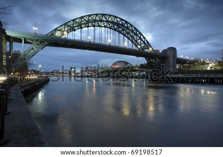 Photograph of the Tyne Bridge in Newcastle upon Tyne/Gateshead at dawn. - stock photo
