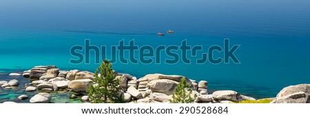 Photograph of two kayaks on calm Lake Tahoe - stock photo
